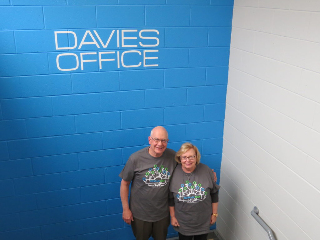 BIll and Evelyn Davies standing in front of Davies sign